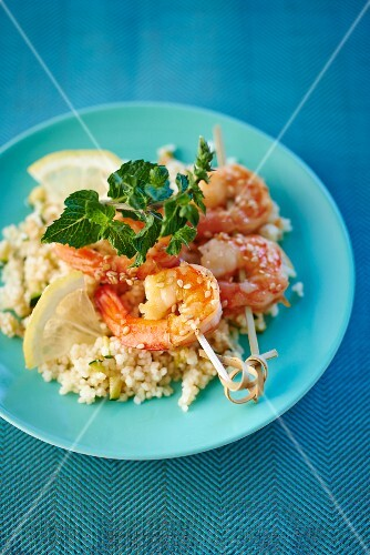 Prawn skewers on a bed of couscous