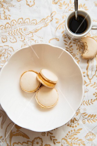 Macaroons with caramel filling, and a cup of coffee