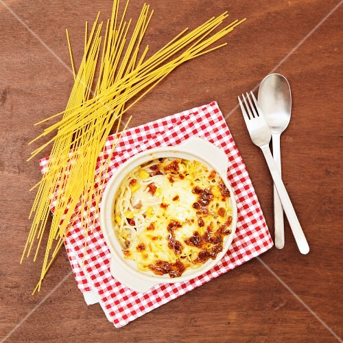 Spaghetti with sweetcorn, topped with cheese sauce and baked