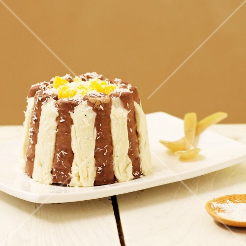 Chocolate charlotte with coconut, mango and pineapple