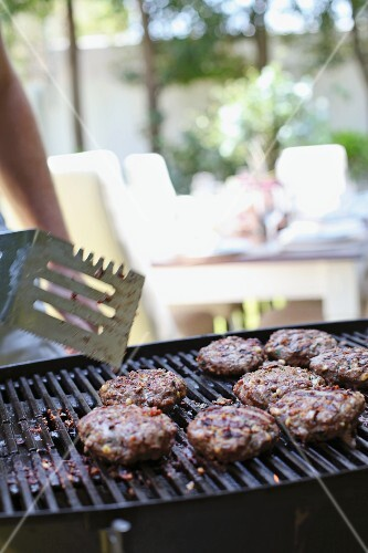 Meat patties on a barbecue