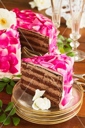 Celebratory layer cake with rose petals