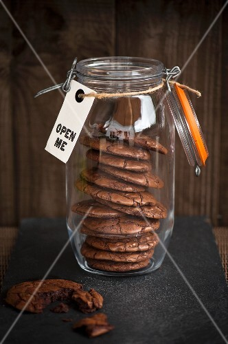 dark chocolate cookies in the jar with the label