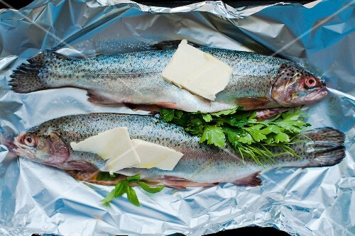 Fresh two Trout garnished ready to be baked