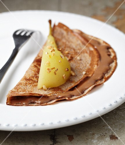 A pancake with chestnut & chocolate cream and a wedge of poached pear