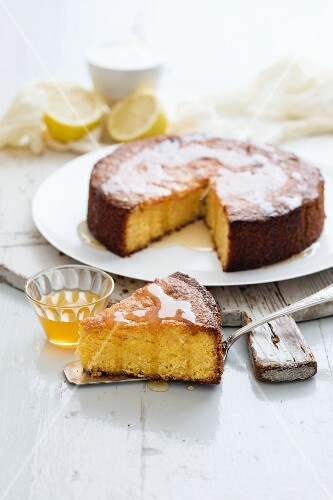 Polenta cake with syrup, partly sliced