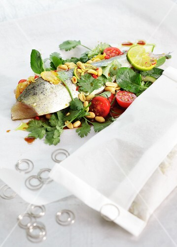 Trout in baking parchment with peanuts and coriander