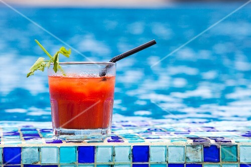 A Bloody Mary cocktail by a swimming pool