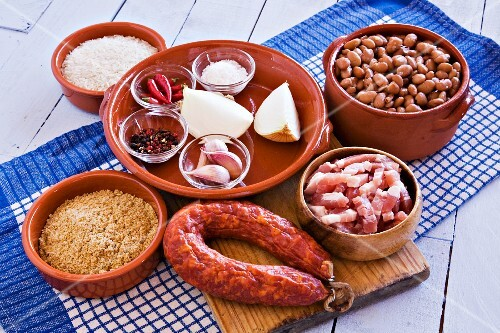 A mixed still life featuring foods from Spanish cuisine