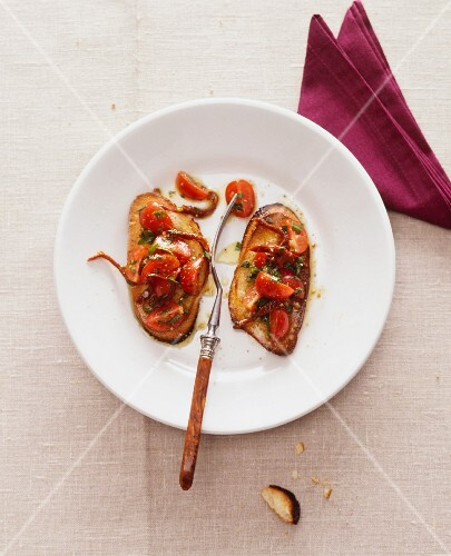 Crostini with tomatoes and anchovy fillets