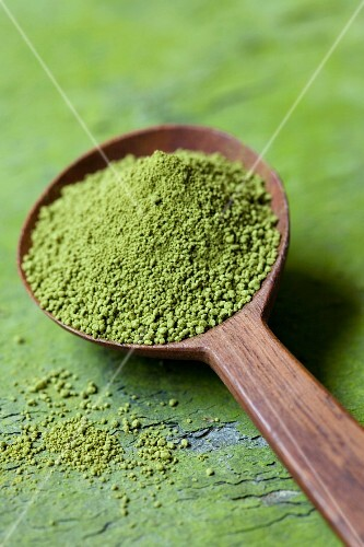 Matcha tea powder on a wooden spoon