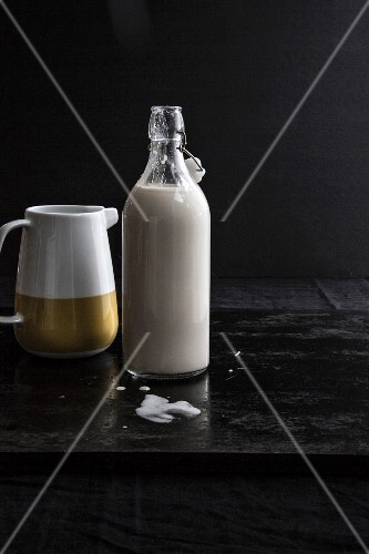 Nut milk in a jug and a bottle