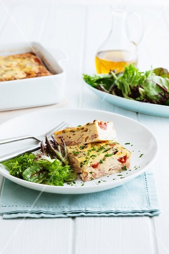 Frittata with ham, cheese, tomatoes and herbs