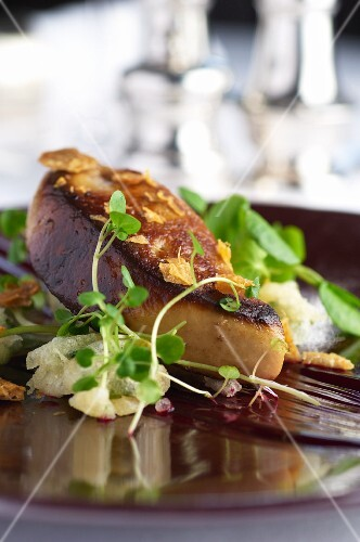 Fried goose liver with pea shoots