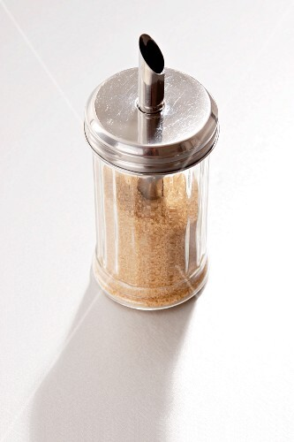 A sugar shaker filled with brown sugar