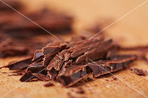 Grated chocolate on a wooden board