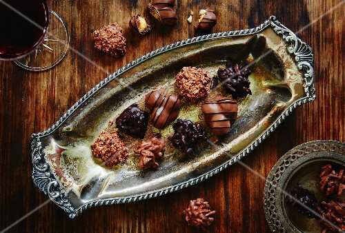 Assorted filled chocolates on an antique tray