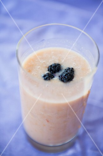 Peach milkshake with blackberries