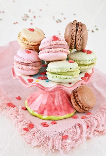 Assorted macaroons with pink sugar hearts