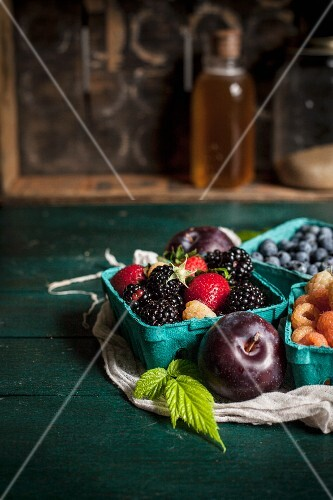 Fresh mixed berries and red plums
