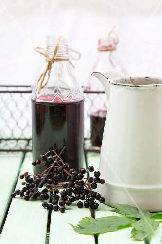 Elderberry juice in glass bottles
