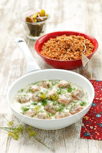 Chicken dumplings with dill sauce and buckwheat