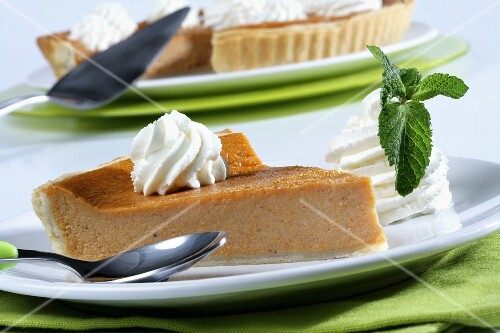 Pumpkin pie portion with whipped cream