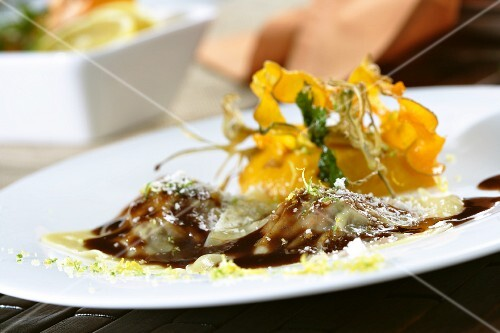 Duck ravioli with pumpkin purée and citrus zest