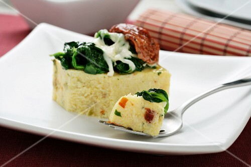 Polenta with sundried tomatoes, spinach and cheese