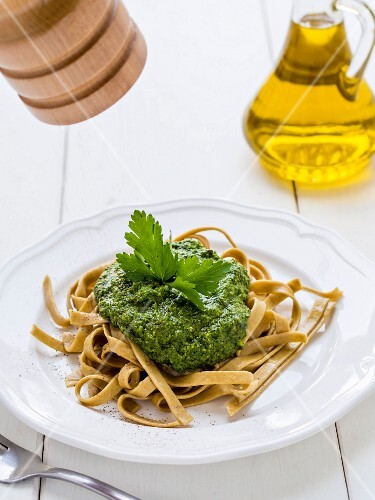 Green pesto served with homemade rye pasta.