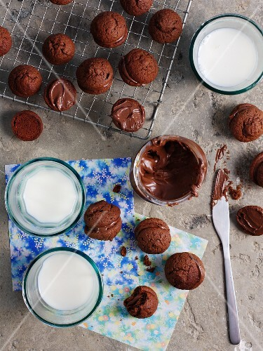 Whoopie Pies with chocolate filling and glasses of milk