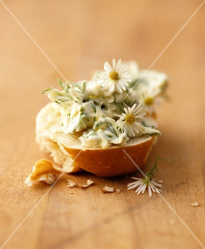 A slice of white bread with daisy butter