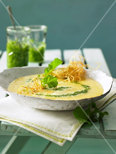 Potato soup with radish leaf pesto and potato straw