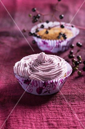 Cupcake with elderberry jam in the mixture and icing