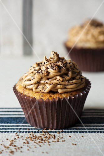 Coffe cupcakes on stripy towel with coffee powder