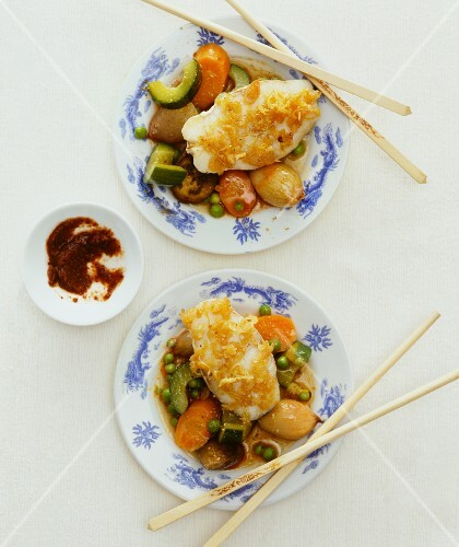 Fish fillet on a bed of vegetables (Asia)
