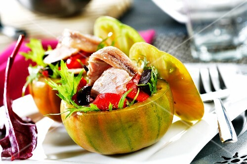 Stuffed tomatoes with tuna salad, olives and peppers