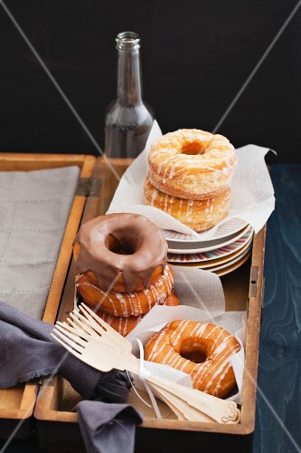 A crossover between doughnuts and croissants, in a wooden crate
