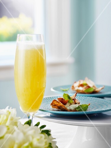 Tandoori chicken and a glass of mimosa