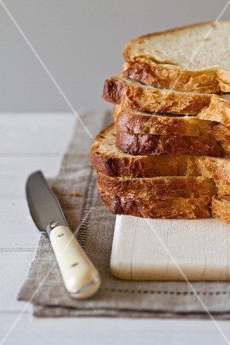 Stacked slices of bread with a knife