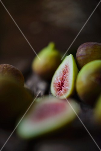 Fresh figs on a wooden surface