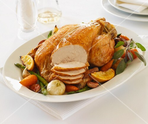 Roast chicken with vegetables, partly sliced