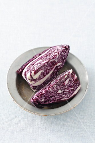Two quarters of red cabbage on a plate