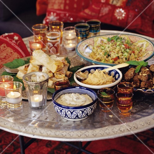 A table laid with assorted dishes from North Africa