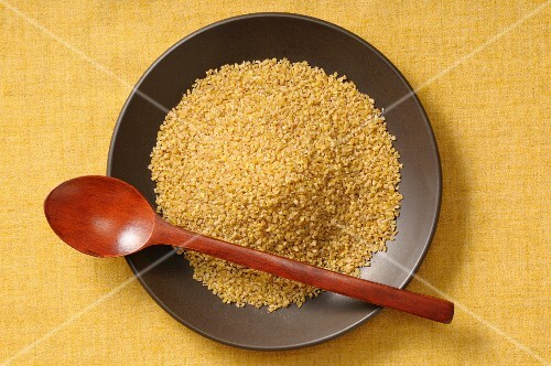 Bulgur in a shallow black bowl