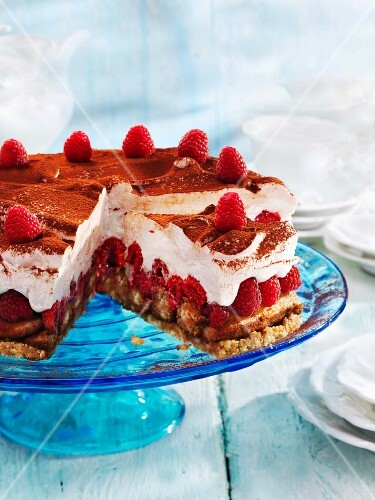 Tiramisu gateau with raspberries, partly sliced