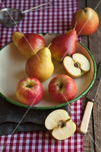 Apples and pears in an old bowl