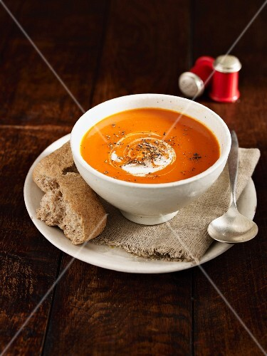 Squash soup with ground black pepper and sour cream