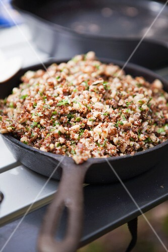 Cooked quinoa in a cast iron pan