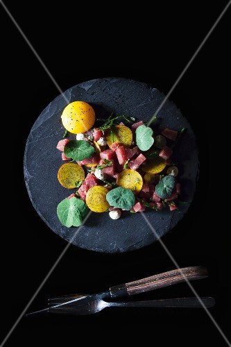 Steak tartare with herbs and an egg yolk